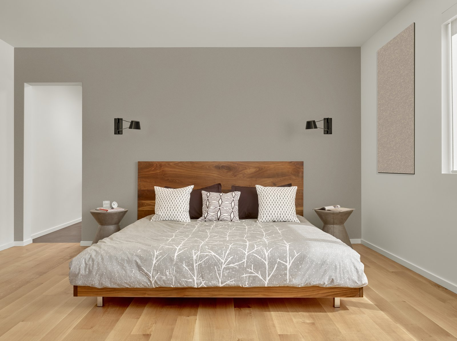 Bedroom, Bed, and Light Hardwood Floor The walnut master bed frame is custom by Matt Eastvold. The sconces are by Brendan Ravenhill.  Trestle Glen Modern by Knock Architecture + Design