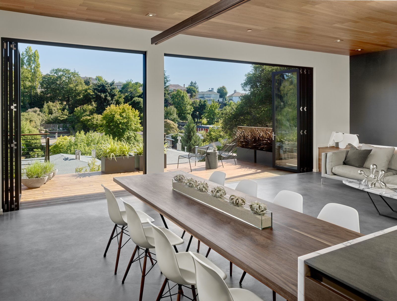 Dining Room, Table, and Chair The foldings doors are by La Cantina, which expand to a redwood deck and the view across the valley.  Trestle Glen Modern by Knock Architecture + Design