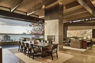Great Room with steel-clad fireplace, concrete floors and wood beams