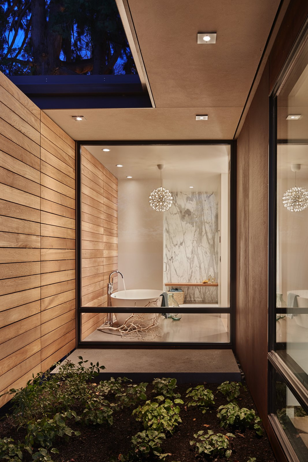 Bath Room, Concrete Floor, Freestanding Tub, Enclosed Shower, Pendant Lighting, and Stone Slab Wall Master Bath  Union Bay Residence by DeForest Architects