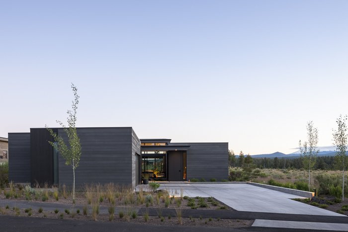 Exterior, Flat RoofLine, House Building Type, and Wood Siding Material Street view  High Desert Modern