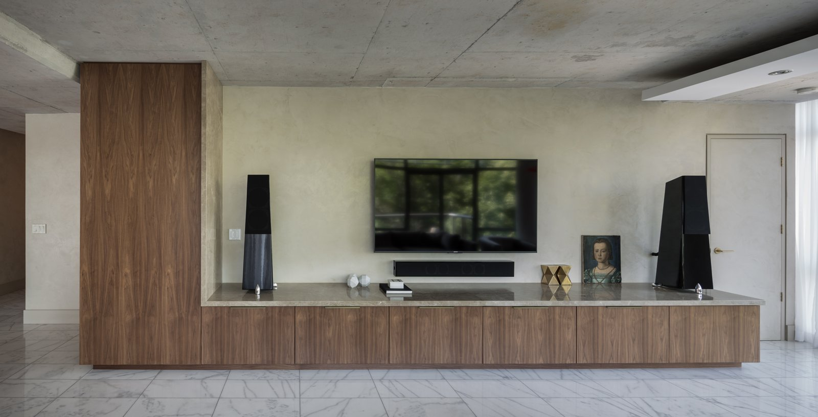 The TV Unit is at an oversized scale relative to the equipment it houses - it was in fact scaled relative to the space and not the equipment.  Thompson Hotel Private Suite by ANTHONY PROVENZANO ARCHITECTS