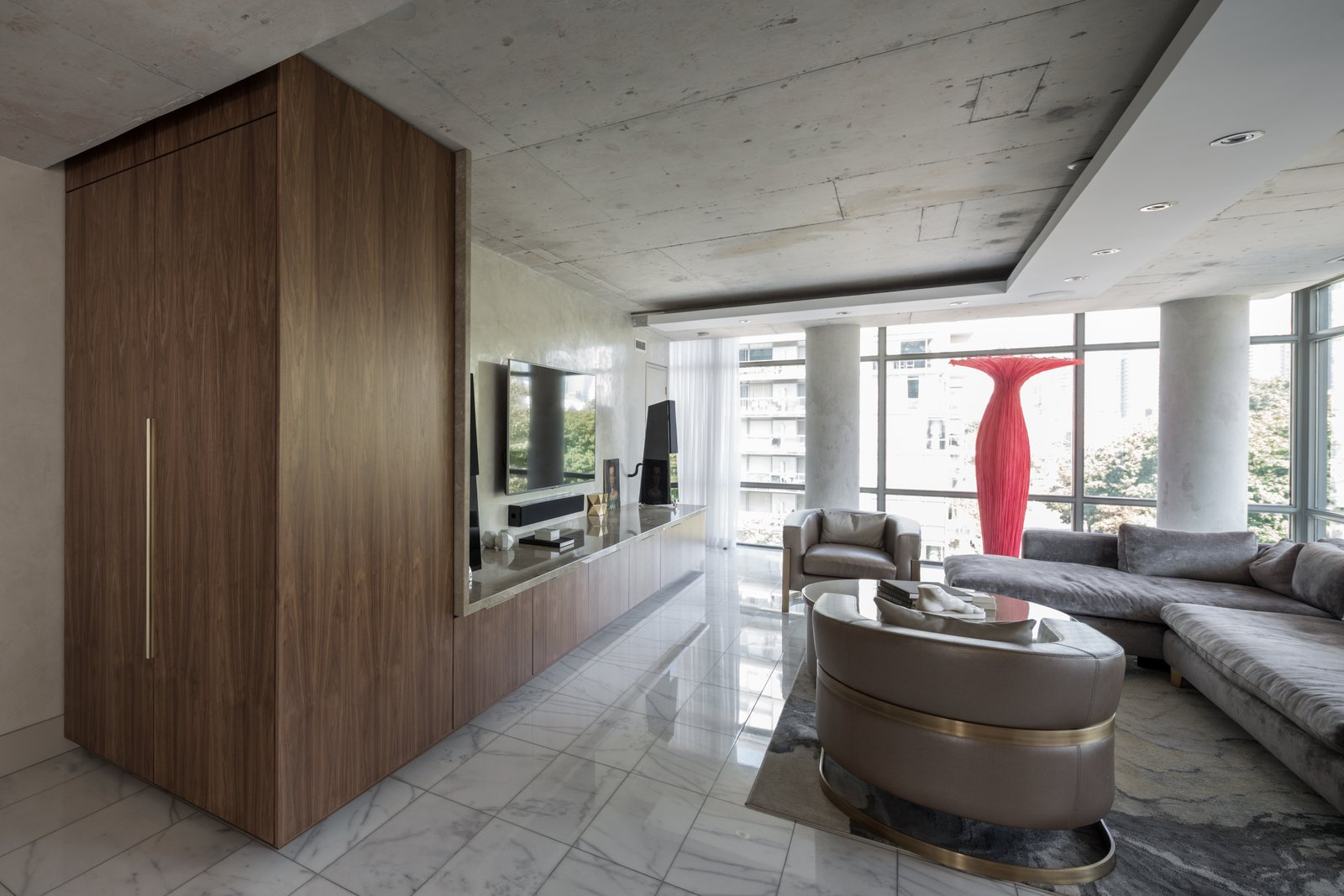 The mass of the TV Unit is heightened at the end, where it folds up into a vertical closet  Thompson Hotel Private Suite by ANTHONY PROVENZANO ARCHITECTS