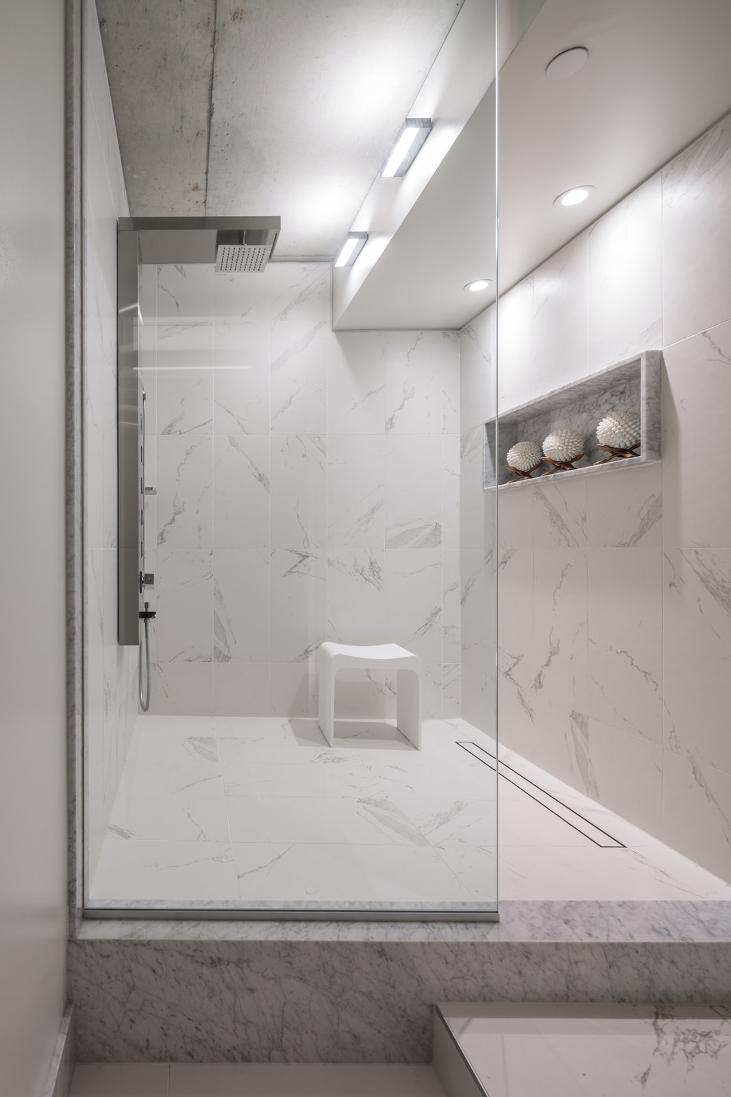 The Master walk=in shower was formerly the kitchen to the next door unit.  Thompson Hotel Private Suite by ANTHONY PROVENZANO ARCHITECTS