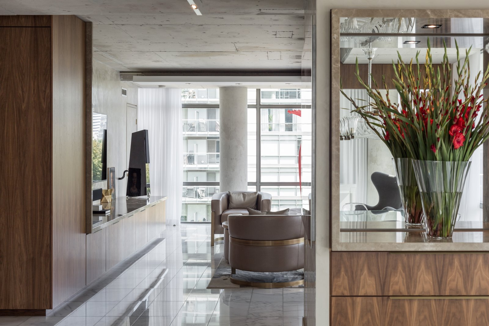 Custom millwork was inserted into the space to not only house it's function, but also give definition to the spaces. The openness or intimacy of spaces are defined by the millwork.  Thompson Hotel Private Suite by ANTHONY PROVENZANO ARCHITECTS