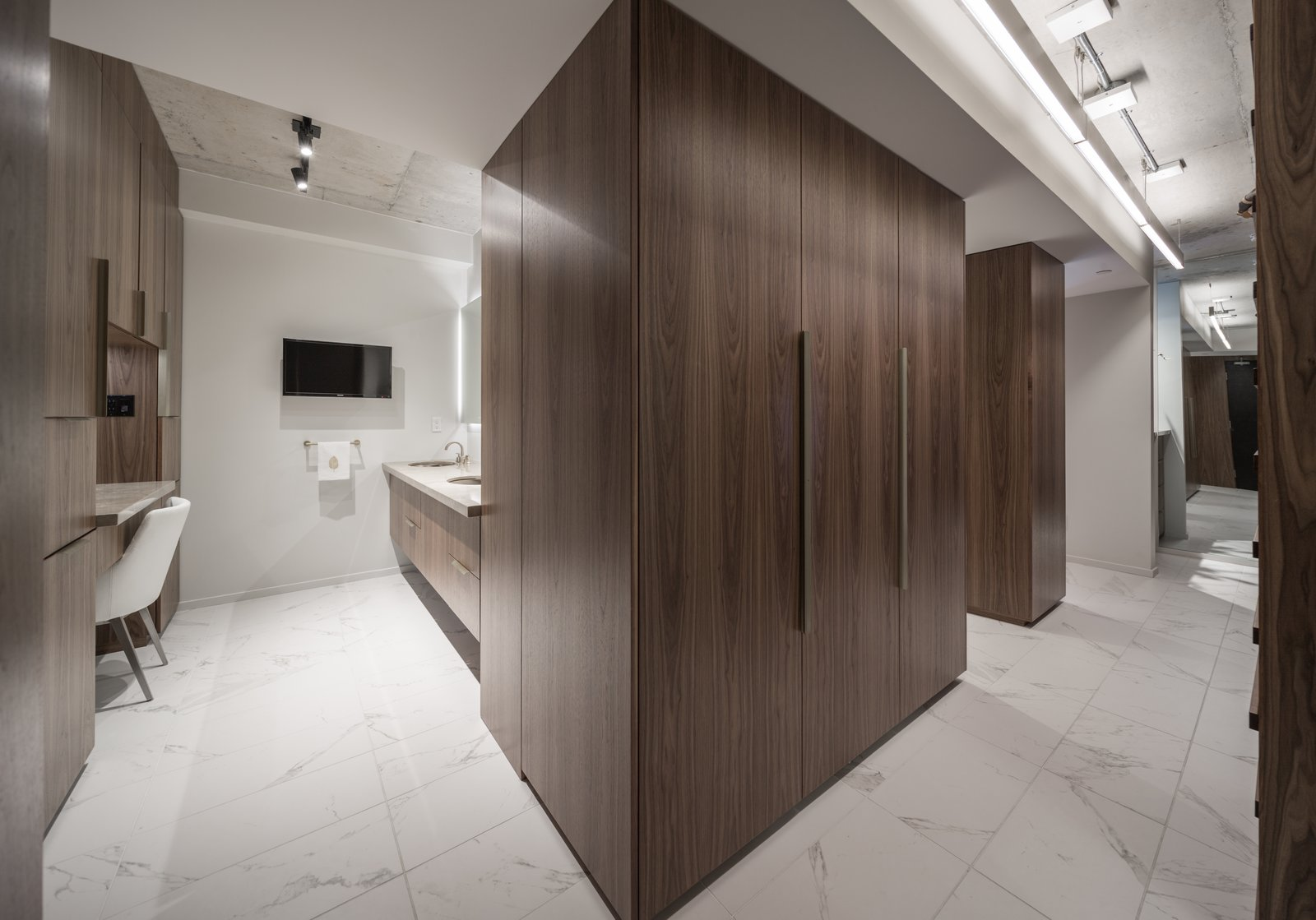 A new double vanity was added on an existing plumbing wall and a makeup counter was added opposite it.  Thompson Hotel Private Suite by ANTHONY PROVENZANO ARCHITECTS