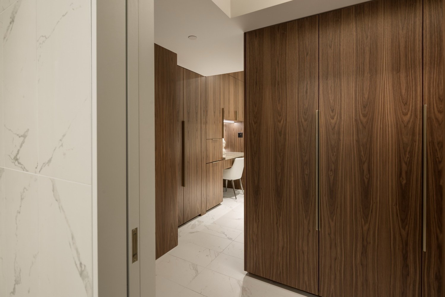 The view to the make-up counter from the walk-in shower.  Thompson Hotel Private Suite by ANTHONY PROVENZANO ARCHITECTS