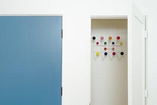 blue entry door + eames hang-it-all at coat closet  [midcentury modern addition / laguna niguel, california]