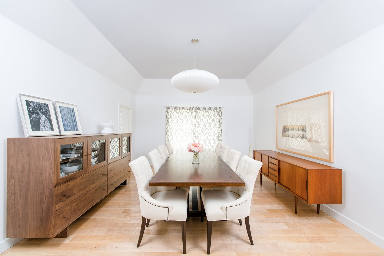 Dining Room, Storage, Chair, Lamps, Table, Ceiling Lighting, Pendant Lighting, Accent Lighting, and Light Hardwood Floor A large nelson bubble lamp and mid-century furniture at the formal dining room complement the painted blue coffered ceiling.  Mid century modern from Villa Park Modern
