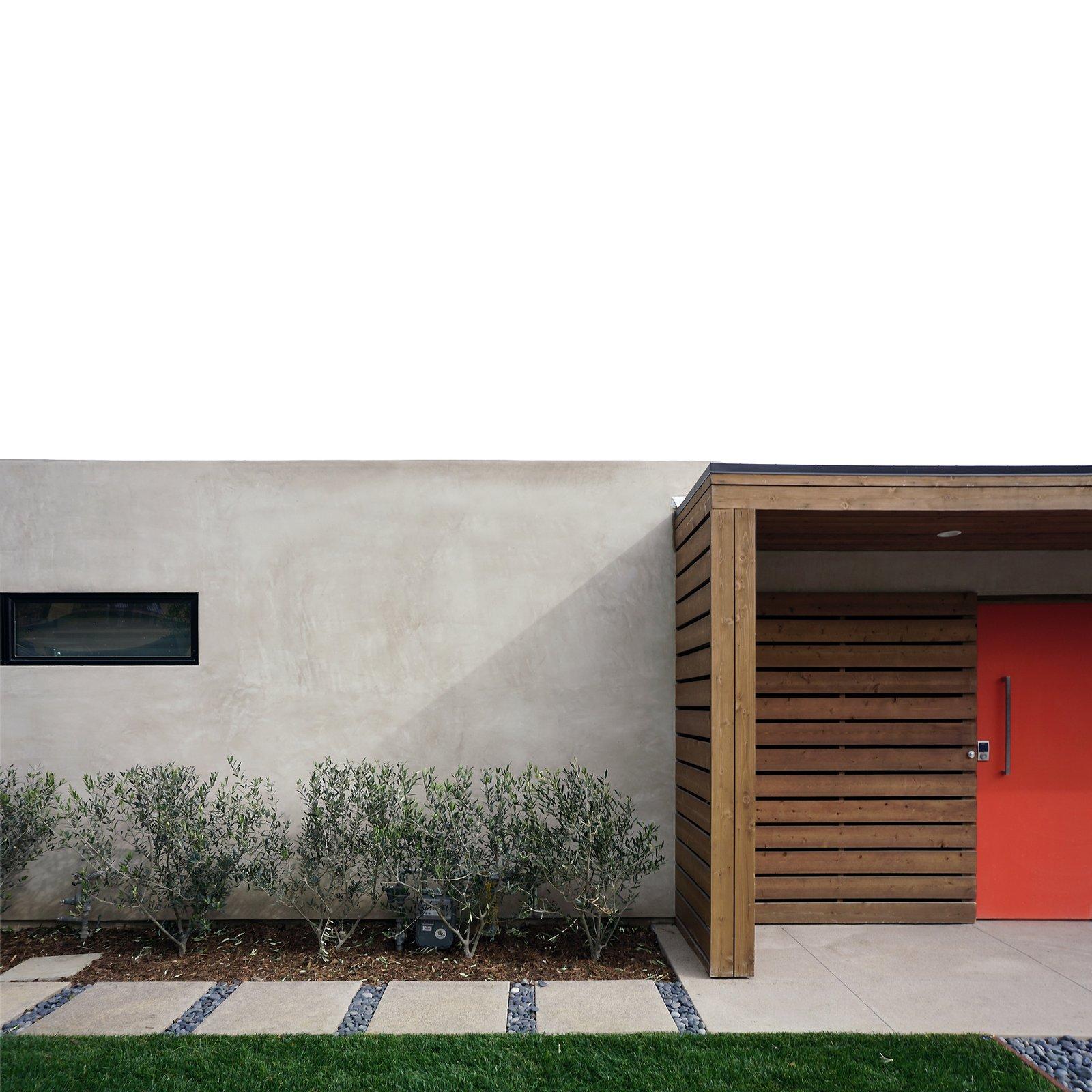concrete, wood slats + smooth stucco at orange pivot door / exterior courtyard entry   [midcentury modern renovation / laguna niguel, california]   Office from Mid century modern