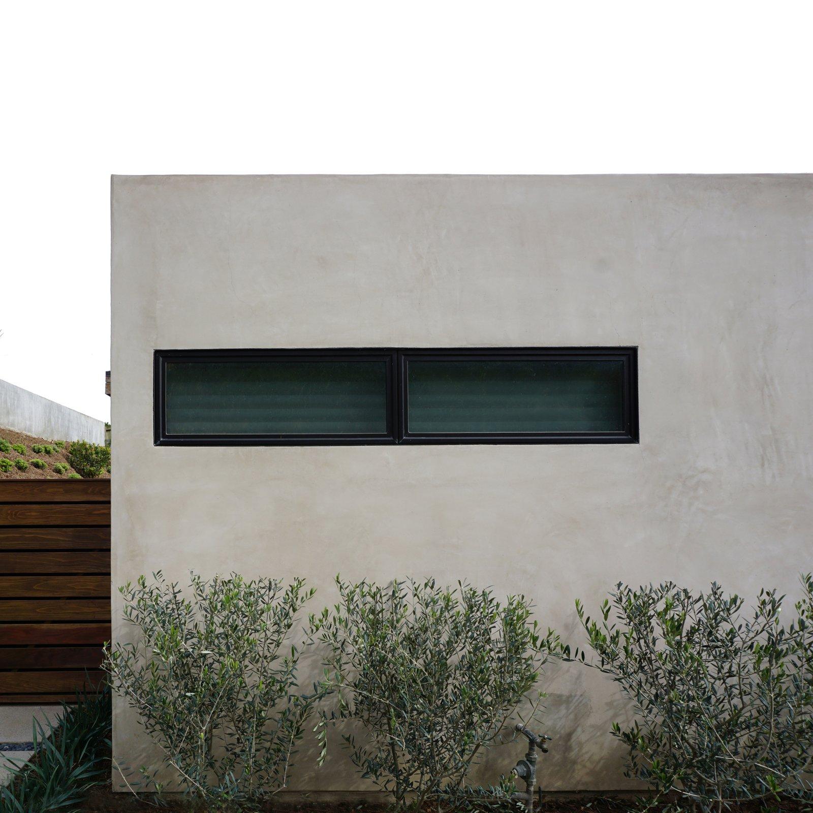 linear window + modern landscaping at midcentury renovation / orange county, california  Mid century modern