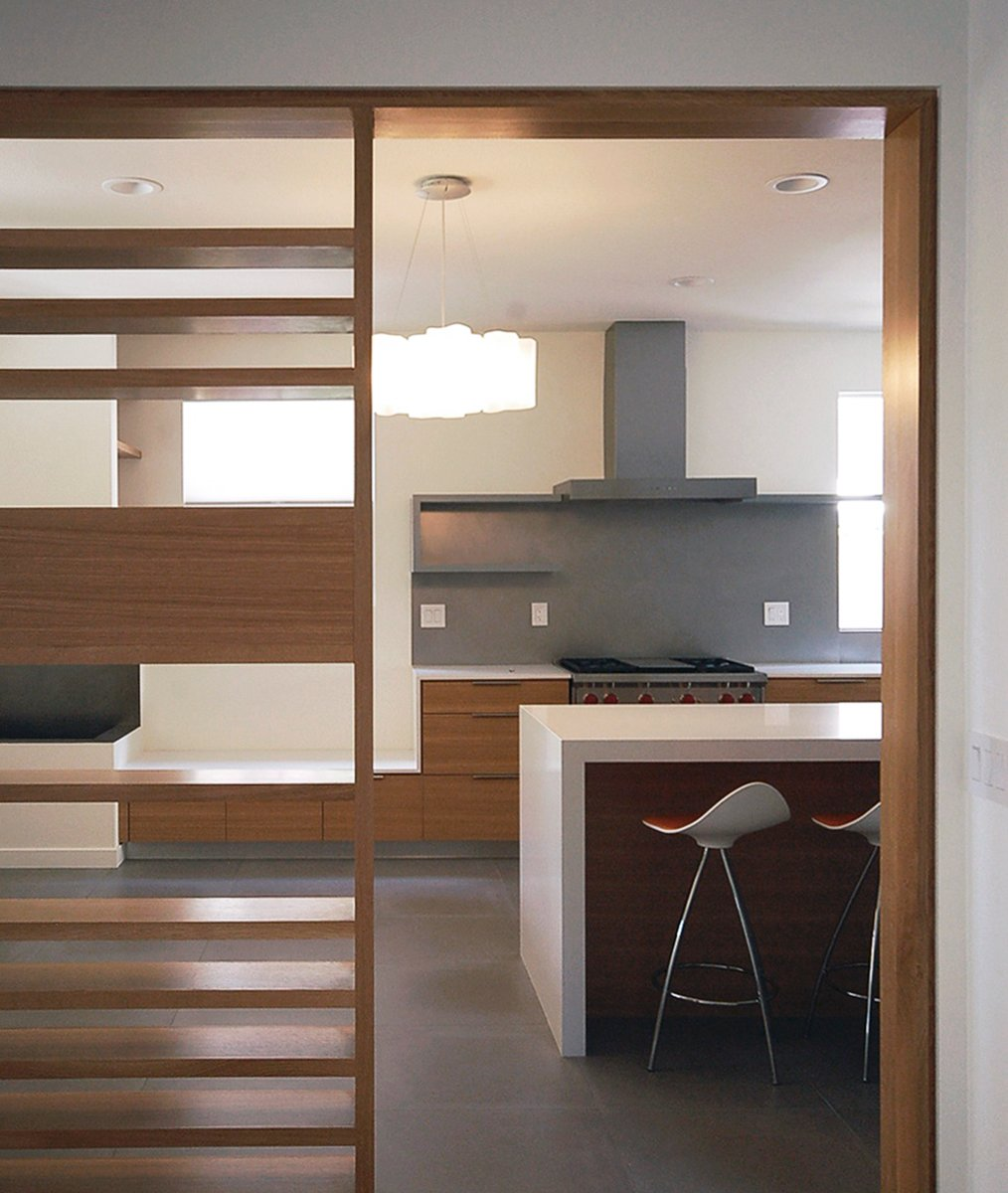 custom rift oak screen at open kitchen  [modern renovation / mission viejo, ca]  Modern Kitchens