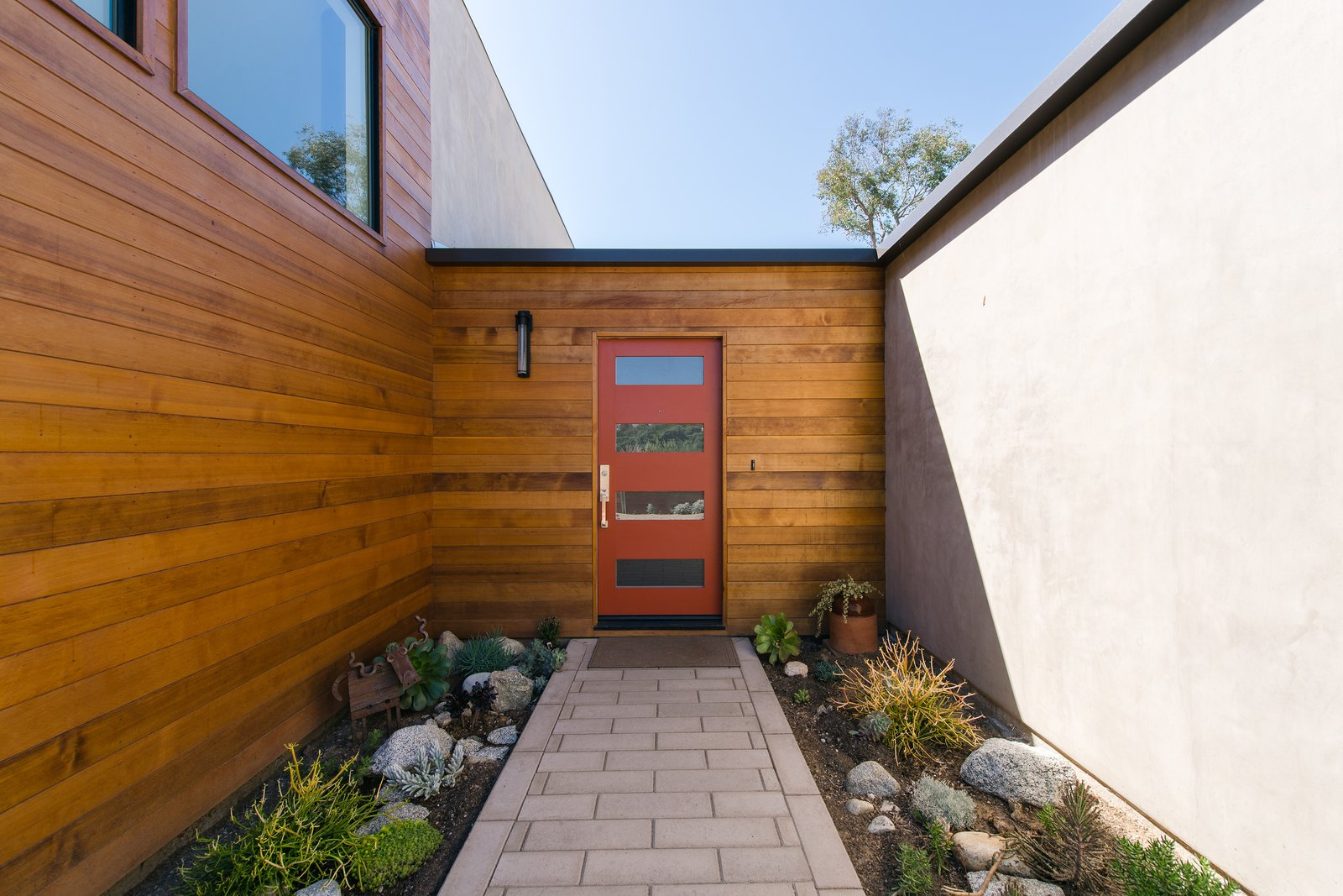 Exterior, Wood Siding Material, House Building Type, Stucco Siding Material, and Ranch Building Type Clear cedar wraps the corner at the approach, adding warmth, texture and visual interest to the entry.  A California Ranch Home, Reimagined by MYD studio, inc.