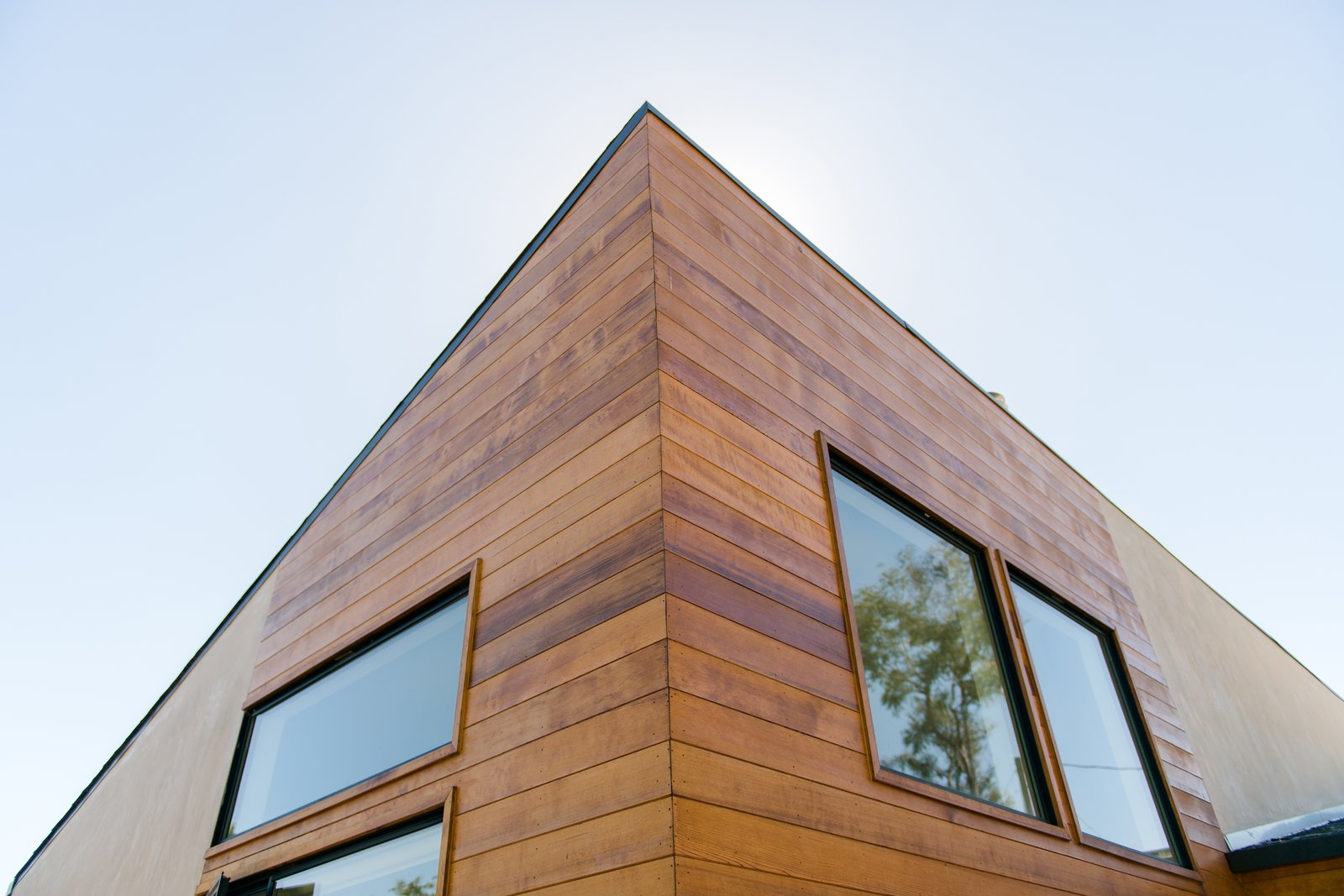 Exterior, House Building Type, Ranch Building Type, Wood Siding Material, and Stucco Siding Material Exterior cedar siding adds asymmetrical interest at the new angled roof at the front addition.  A California Ranch Home, Reimagined by MYD studio, inc.