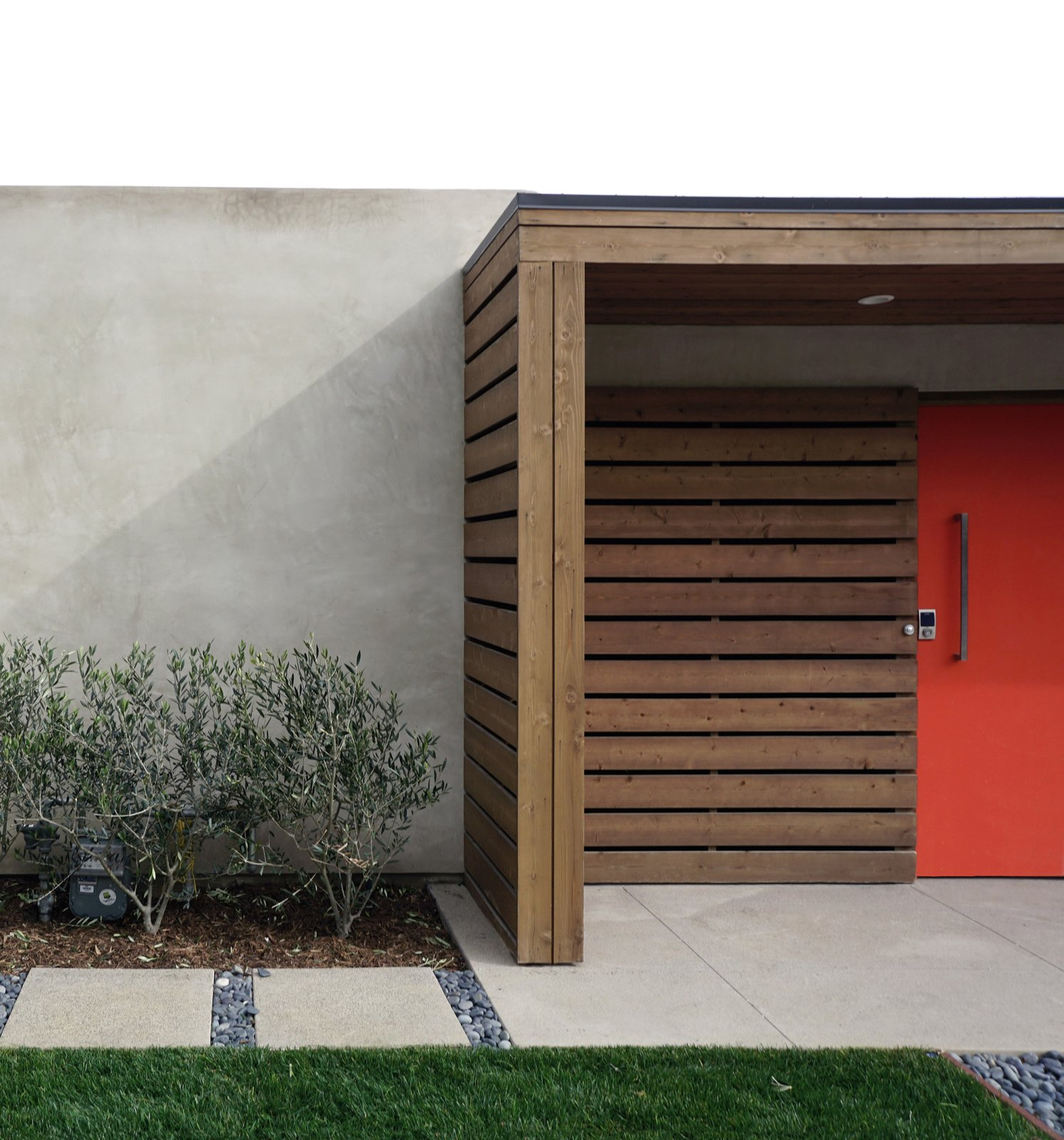Exterior, Swing Door Type, Outdoor, Front Yard, Walkways, Hardscapes, Grass, Shrubs, Small Patio, Porch, Deck, Wood Patio, Porch, Deck, Concrete Patio, Porch, Deck, Horizontal Fences, Wall, and Wood Fences, Wall Concrete, grass, gravel and cedar at courtyard entry.  Laguna Niguel Mid-Century by MYD studio, inc.