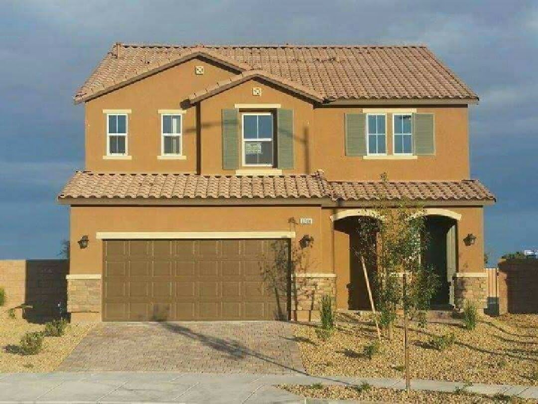 Exterior, Tile Roof Material, A-Frame RoofLine, Stucco Siding Material, and House Building Type Photo of the Jones' Las Vegas Home (Cartwheel), one day after completion.  Cartwheel