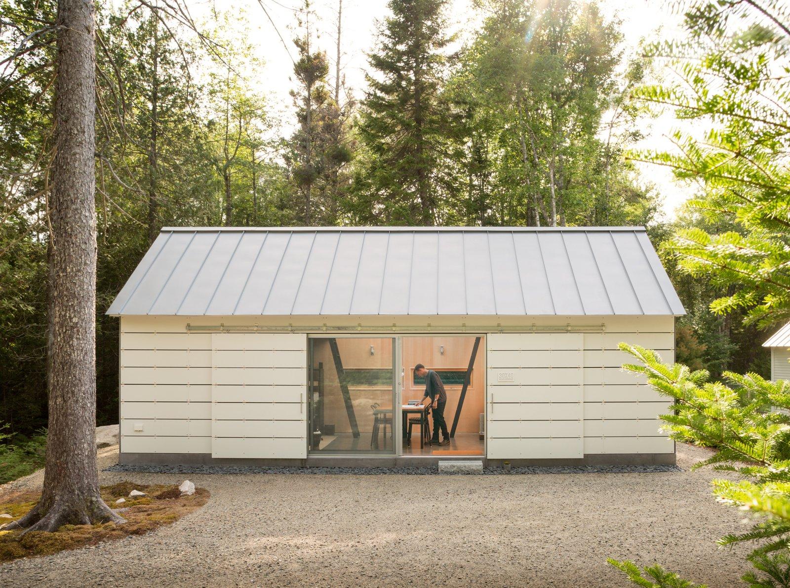Office, Chair, Desk, and Concrete Floor Studio Entry Court  The Long Studio by 30X40 Design Workshop