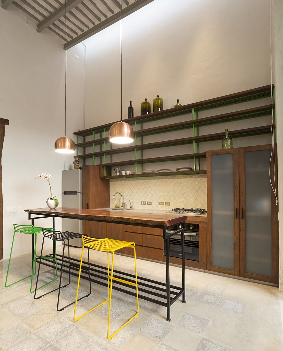 Kitchen, Wood, Engineered Quartz, Wood, Ceramic Tile, Pendant, Refrigerator, Cooktops, and Undermount Tropical wood Tzalam add warm to the space.   Best Kitchen Wood Wood Undermount Ceramic Tile Photos from Lemon Tree House