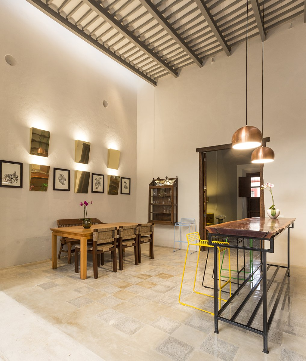Dining Room, Wall Lighting, Pendant Lighting, Chair, Table, Shelves, and Cement Tile Floor The old ceilings and walls of the existing structure  were preserved to keep the spirit of the old house  Lemon Tree House by Taller Estilo Arquitectura S de R.L de C.V
