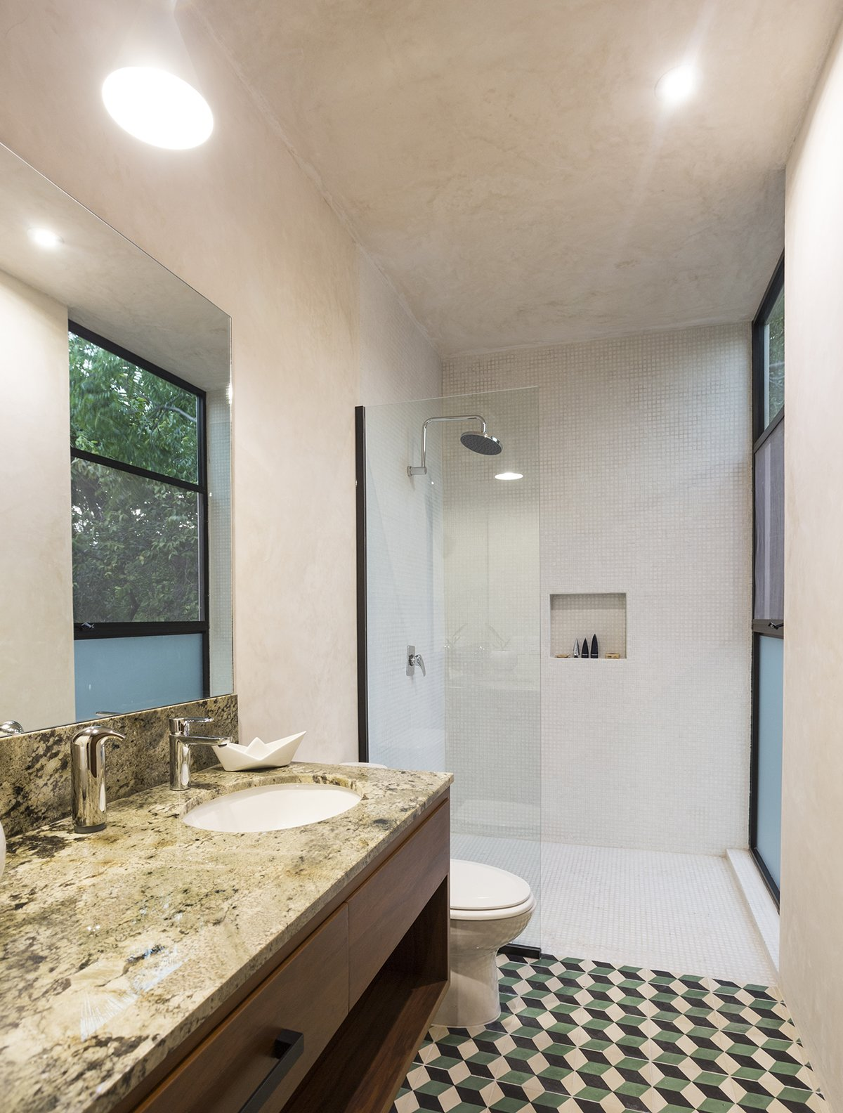Bath Room, Marble Counter, Open Shower, Cement Tile Floor, Undermount Sink, Pendant Lighting, Concrete Wall, and One Piece Toilet White polished concrete walls contrast with the colorfull Cement Tiles and the Marble on counter  Lemon Tree House by Taller Estilo Arquitectura S de R.L de C.V