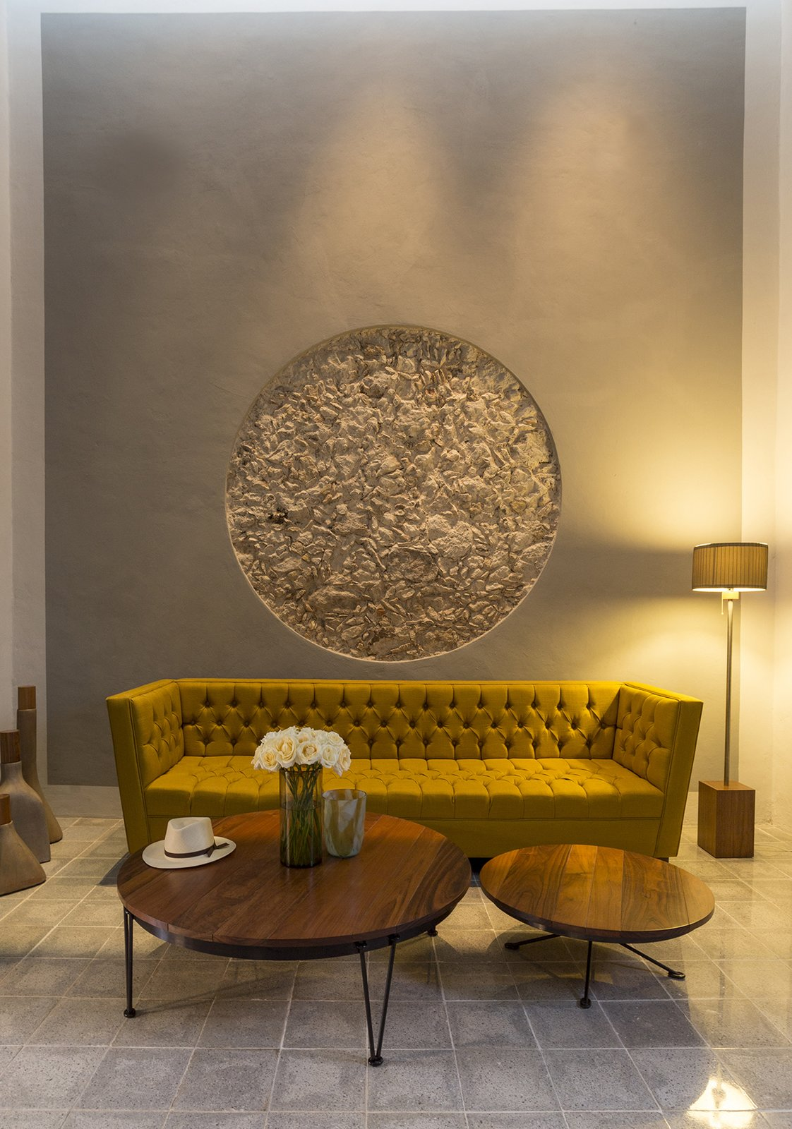 Living Room, Sofa, Coffee Tables, Track Lighting, and Cement Tile Floor The existing Stone walls were preserved and just exposed in one spot of the house to remid the preexisting building  Lemon Tree House by Taller Estilo Arquitectura S de R.L de C.V
