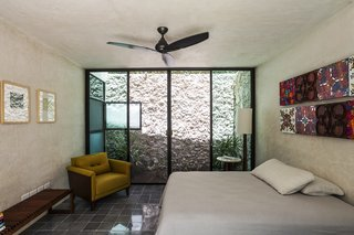 A Light well provide natural light and ventilation to the downstairs bedroom