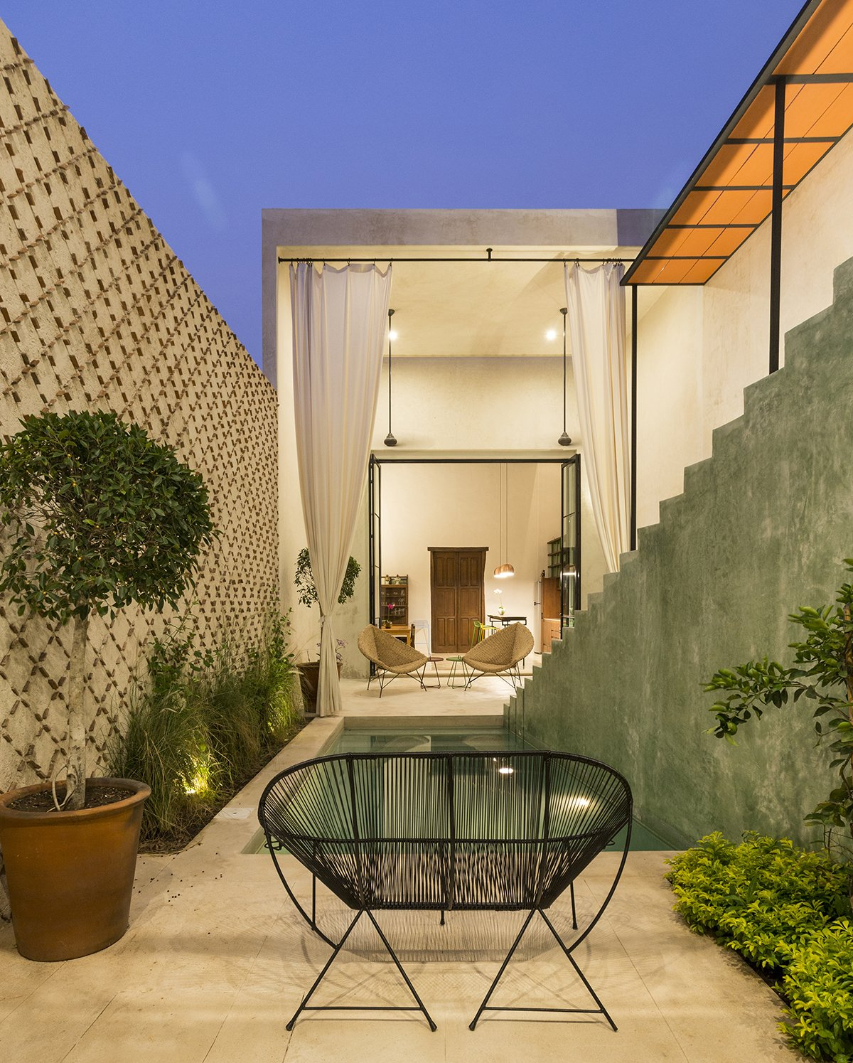 Outdoor, Plunge Pools, Tubs, Shower, Trees, Grass, and Small Patio, Porch, Deck A panoramic view from the seating area outside of the downstairs bedroom  Lemon Tree House by Taller Estilo Arquitectura S de R.L de C.V