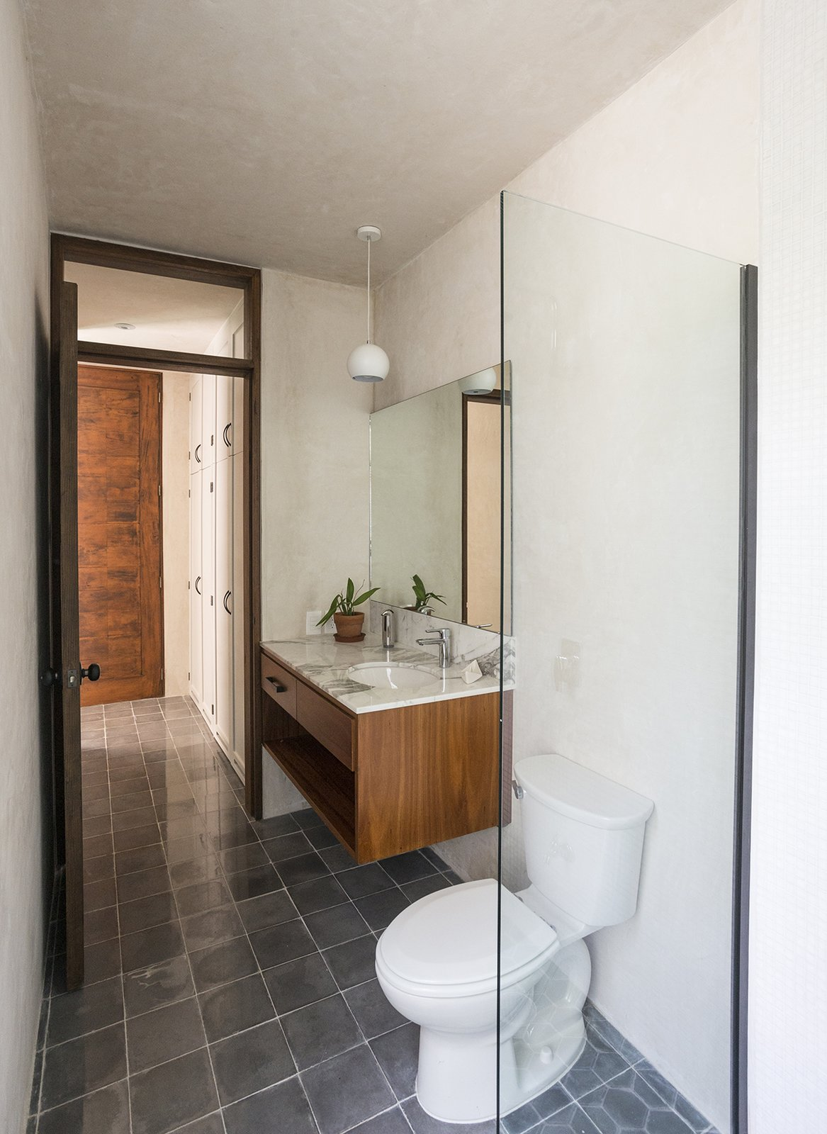 Bath Room, Marble Counter, Undermount Sink, and Cement Tile Floor Downstairs bathroom  Lemon Tree House by Taller Estilo Arquitectura S de R.L de C.V