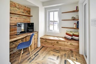 This office space also boasts reclaimed barn wood and features a built-in desk and storage tucked away under the built-in bench.