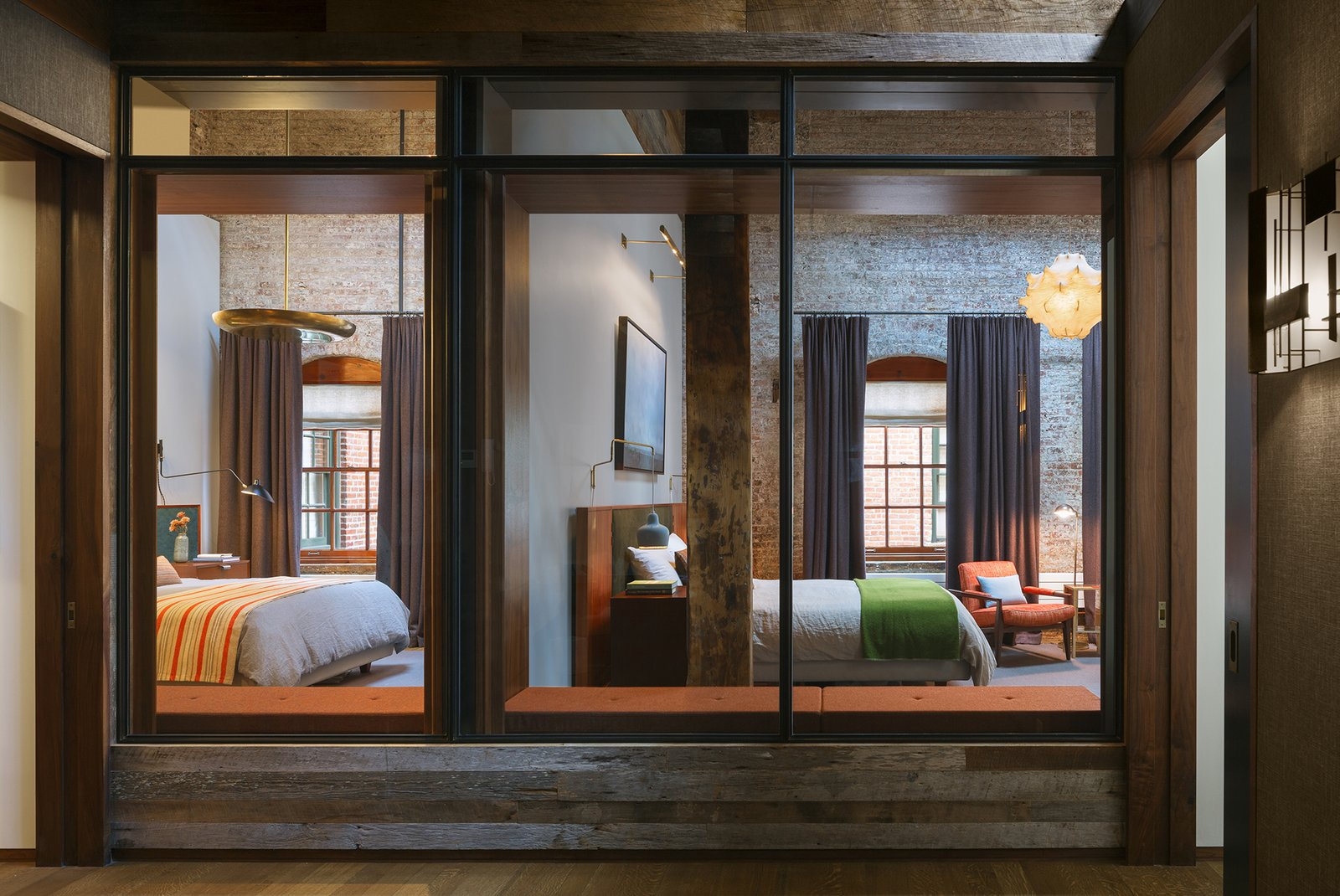 To bring light deep into the loft, the floor plan is open with glass partitions instead of solid walls at the north end of the loft.  Tribeca Loft by Andrew Franz Architect PLLC