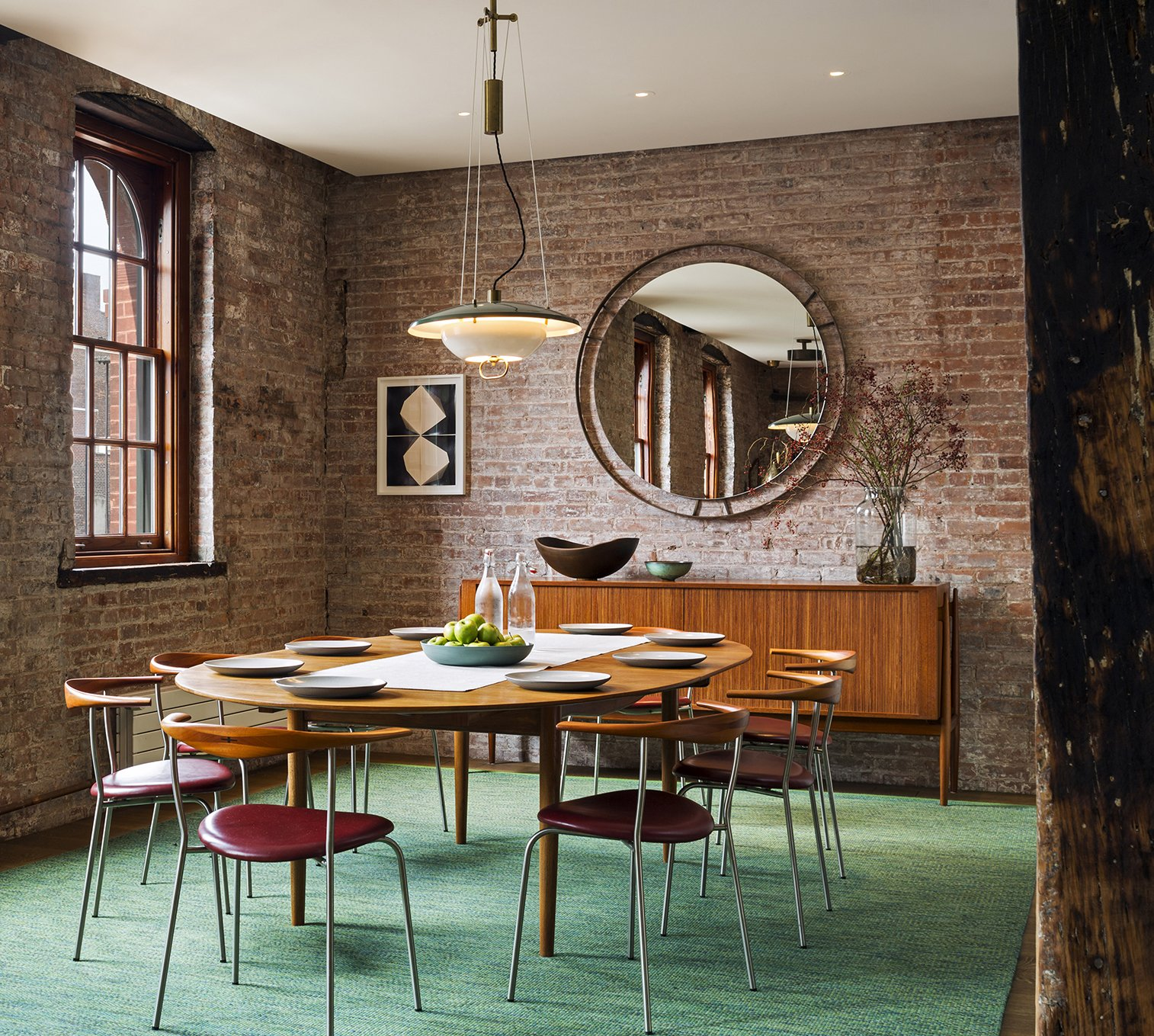 Light and open vintage furnishings contrast with the industrial character of the space.  Tribeca Loft by Andrew Franz Architect PLLC
