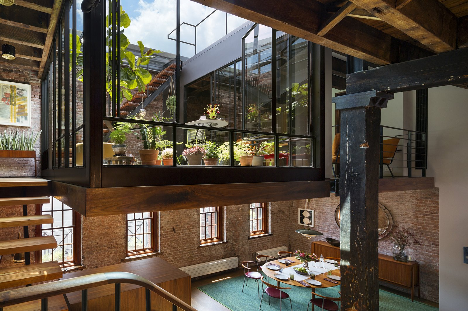 The court exposes the sky, fills the previously dark loft with natural daylight, and brings accessible outdoor space into the primary living zones.  Lush Life from Tribeca Loft