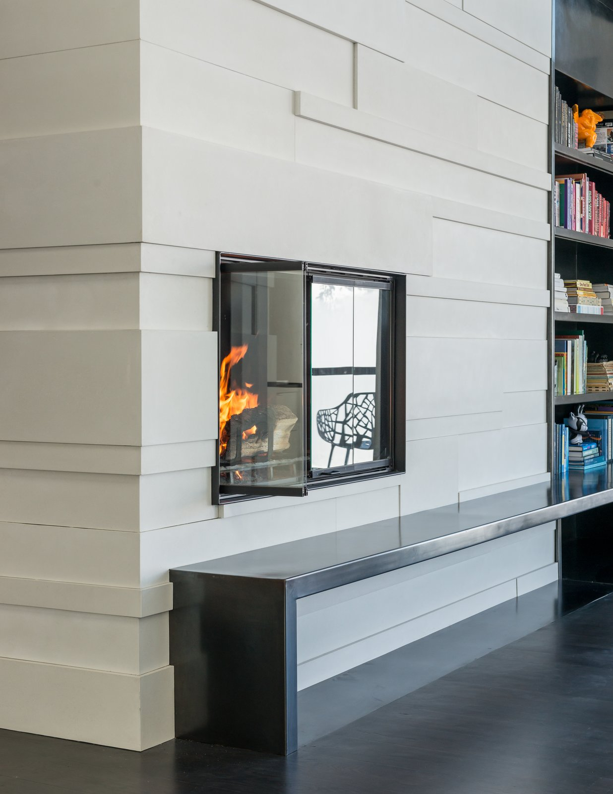 Custom concrete tiles and a steel hearth complete the fireplace surround.  San Francisco Meets Jackson Hole in a Modern Renovation