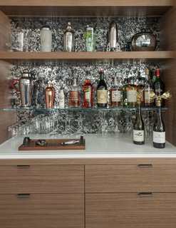 "Living Room Bar wallpaper:  Flavor Paper, 'Where's Andy,"" in chrome mylar."