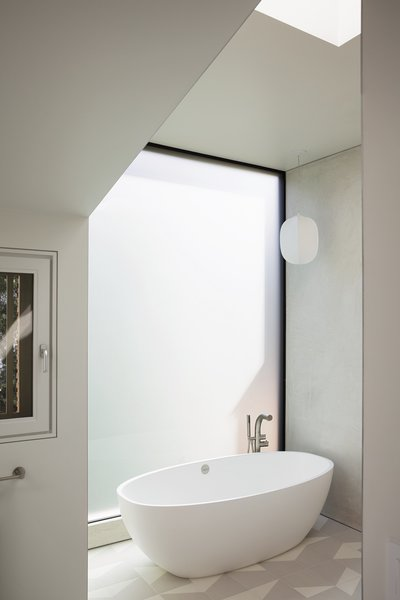 A previously muggy master bathroom was transformed into a light, open space.