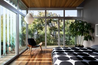 Guest room sliders open up 2 walls to the outside with glass louvers
