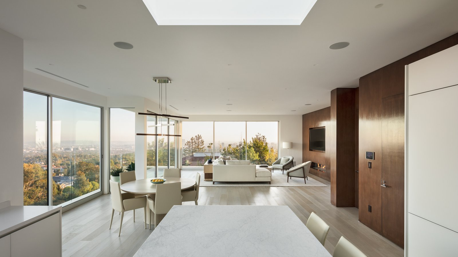 Dining, Light Hardwood, Chair, Recessed, Stools, Pendant, Table, Ceiling, Bar, Gas Burning, and Ribbon View from Kitchen   Best Dining Light Hardwood Ceiling Recessed Photos from Minimal House One