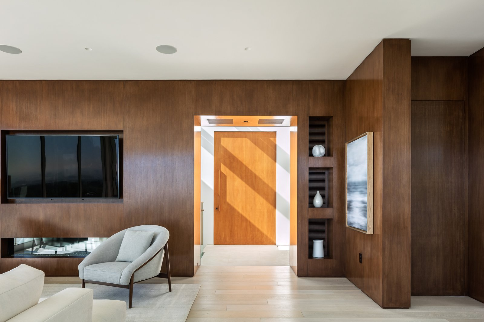 Living, Accent, Ceiling, Sectional, Light Hardwood, Gas Burning, Ribbon, Bookcase, Recessed, Chair, Sofa, and Limestone Reclaimed Walnut and View to Stairway Skylight  Best Living Light Hardwood Limestone Photos from Minimal House One