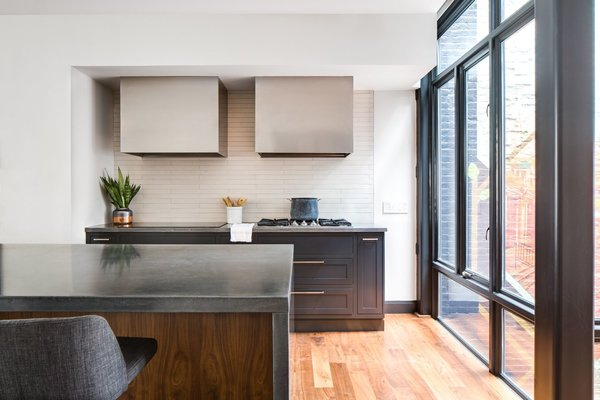 All of the main spaces, sandwiched between the garage and utility room and street, are brought to life by the natural light provided by the a new four-story light-well.
