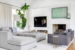 The designer created a family room is cozy enough for the family to all relax together, but still polished and modern.