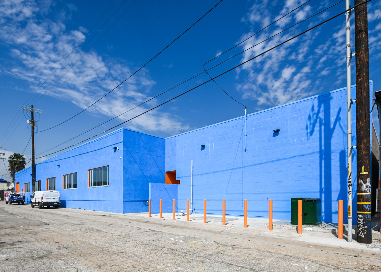 Exterior, Stucco Siding Material, and Curved RoofLine Rear building alley exterior  HATCHlabs @LA Bioscience HUB