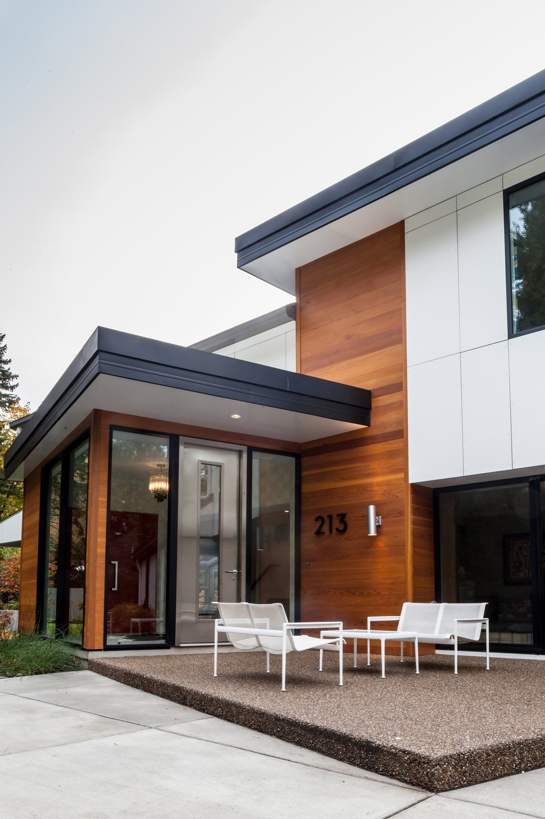 While maintaining the existing house structure, an entirely new, modern home was created from new interiors placed on to a new exterior skin. The entire exterior was revised with new cladding, metal roof, insulation, and windows. An addition opened the space to embrace higher ceilings and to introduce varying floor levels in order to create a fresh, dynamic flow within the home. The re-cladding of the house allowed for a complete change in the home's style while also completing significant thermal improvements.  Creek Drive Residence by mossArchitects