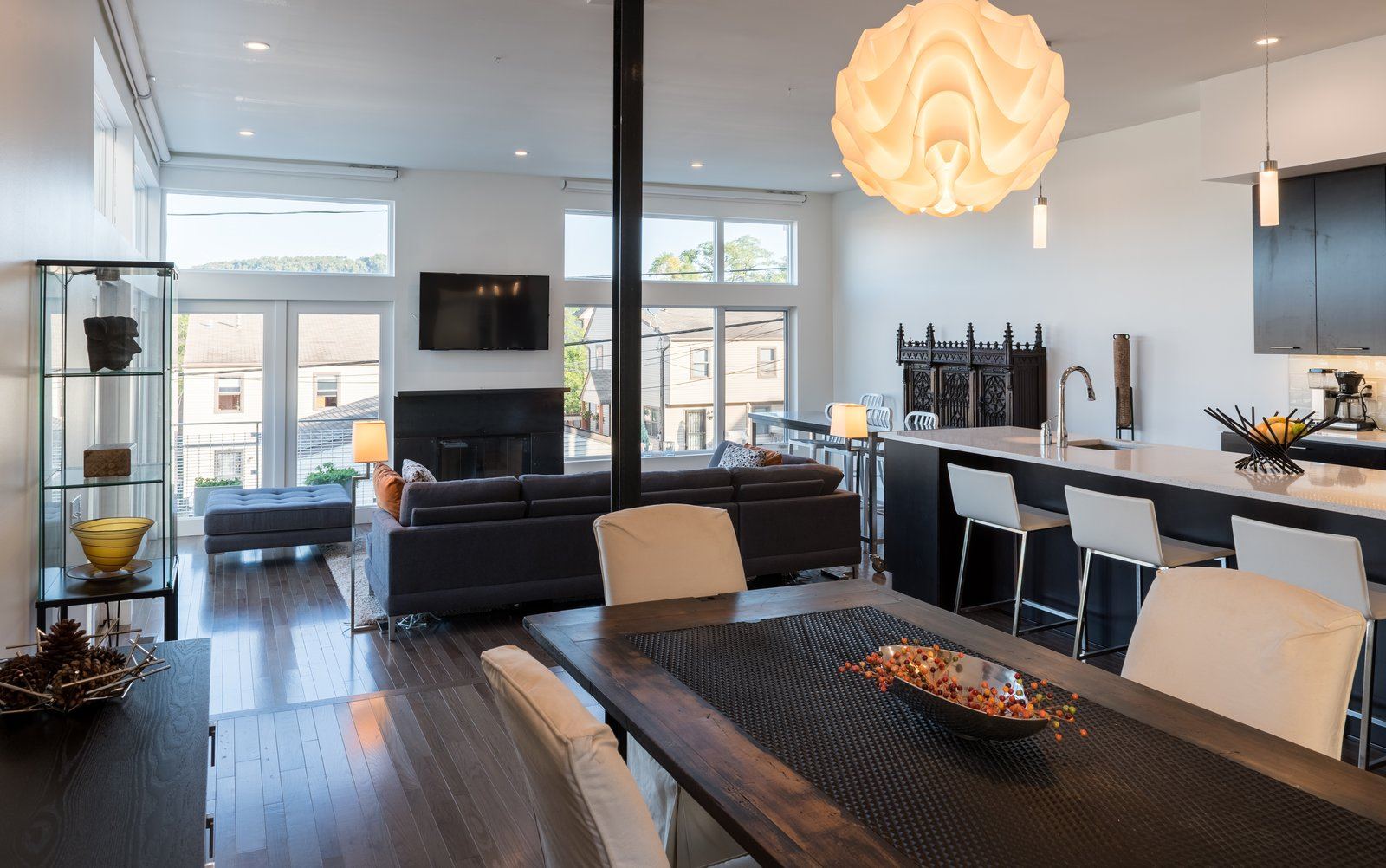 A large, open plan great room containing the kitchen, dining, and family room functions are located at the northwest portion of the floor plan, allowing for views of downtown Pittsburgh.  Ligonier Street Residence by mossArchitects