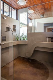 Monolithic concrete 3/4 Bath. Sink, shower, and planter use all the same in-line drain by Infinity.