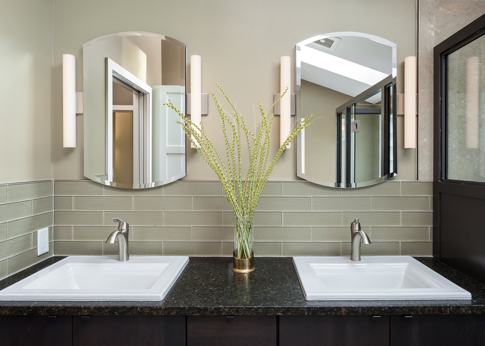 Dual, white square-shaped sinks make the perfect modern bathroom vanities for granite countertops, like the contrasting black one seen here.   Photo 23 of 25 in 25 Best Modern Bathroom Vanities For Your Home from The Ping Pong Home