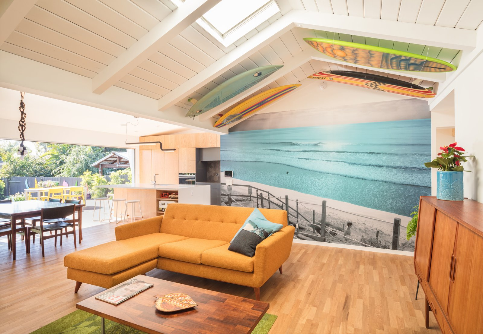 Open plan + Vintage surfboards + Engineered white Oak FSC  Kentwood flooring from Metrofloors.com  The Beach Lab by Surfside Projects