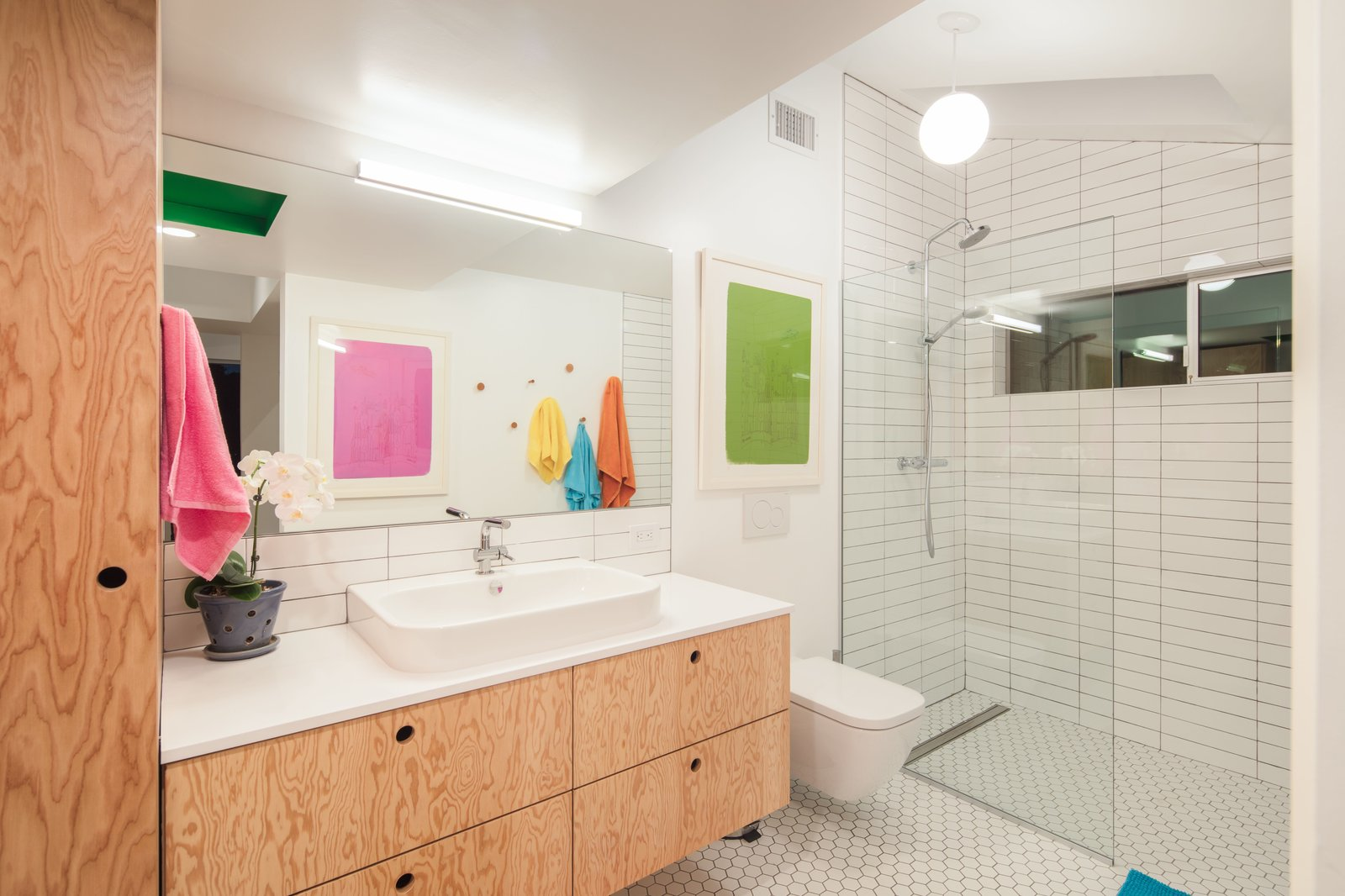 A floating Doug Fir plywood vanity + Duravit Happy D sink & wall hung toilet  The Beach Lab by Surfside Projects