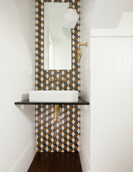 backsplash wall in the powder room with Heath Ceramics tile and Schoolhouse Electric light fixture