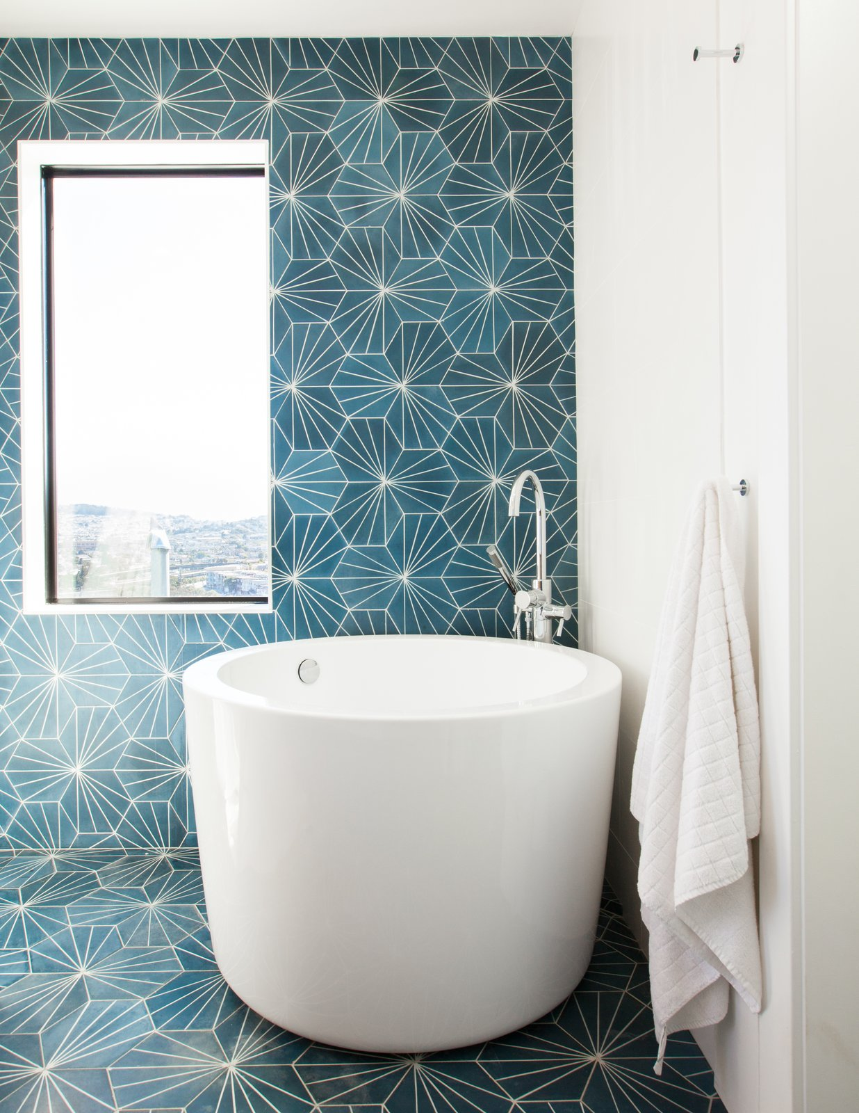 Bath Room, Cement Tile Floor, Soaking Tub, Open Shower, Recessed Lighting, and Ceramic Tile Wall soaking tub in a corner of the master bathroom  Glen Park House by McElroy Architecture