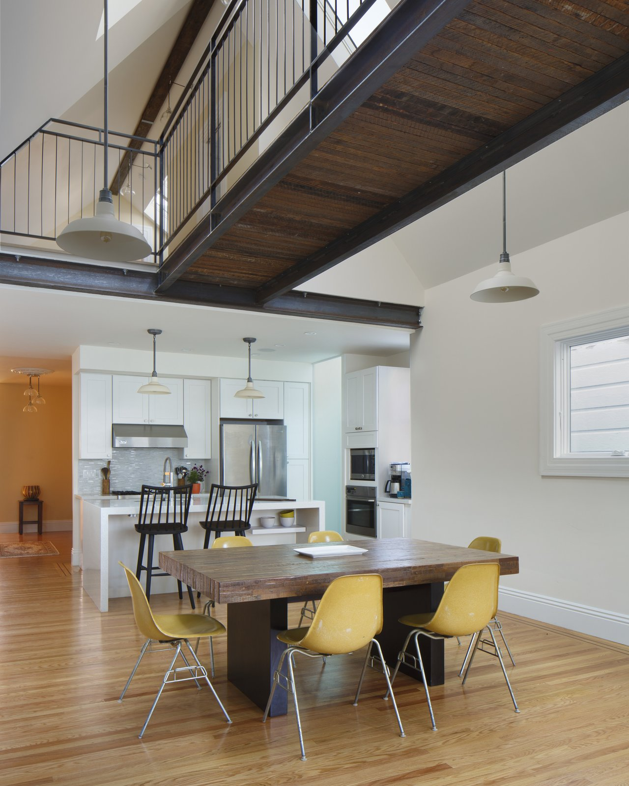 Staircase, Metal Railing, and Wood Tread new bridge and hangout space above  Bridge House by McElroy Architecture